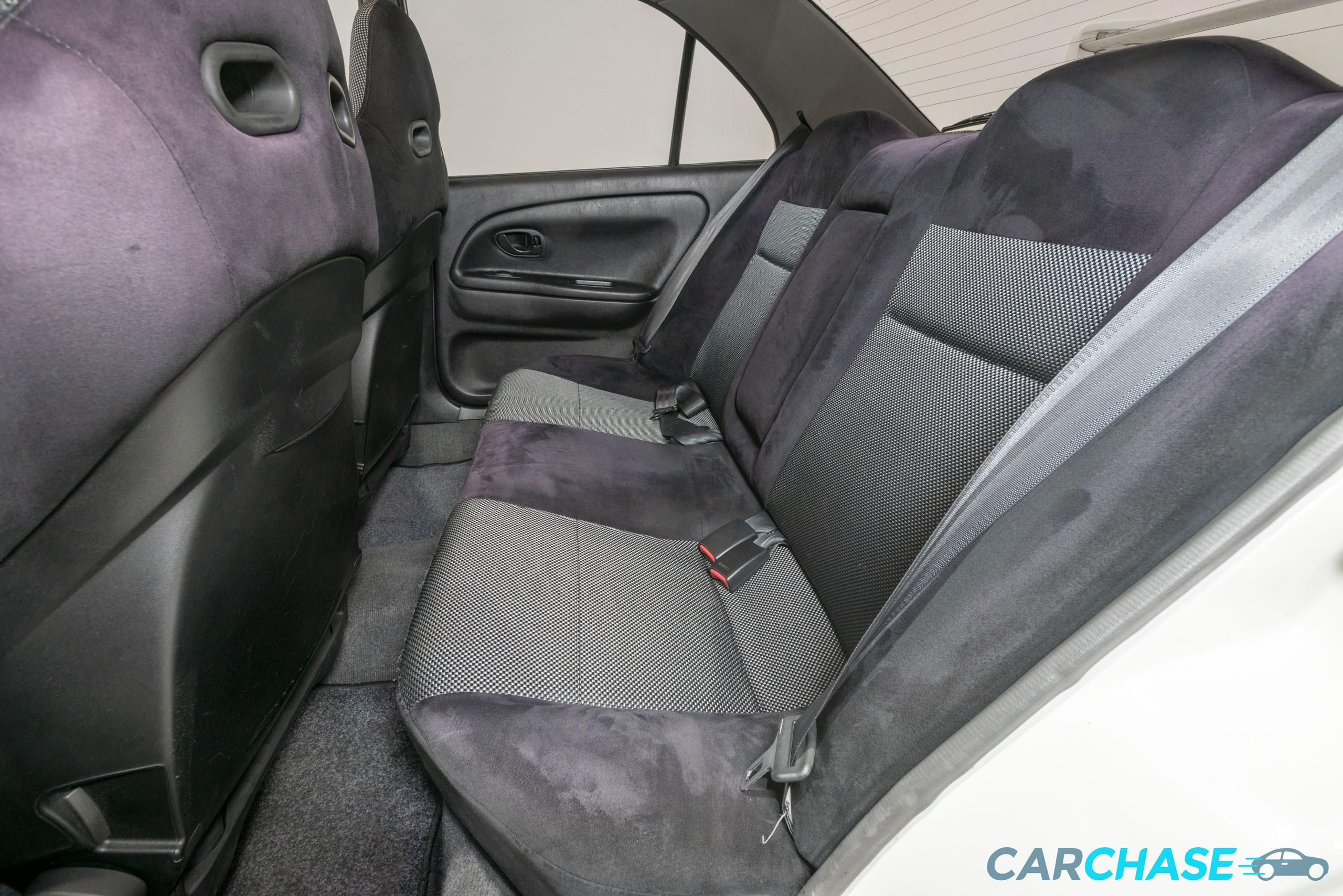 Image of passenger rear profile of 1998 Mitsubishi Lancer Evolution V