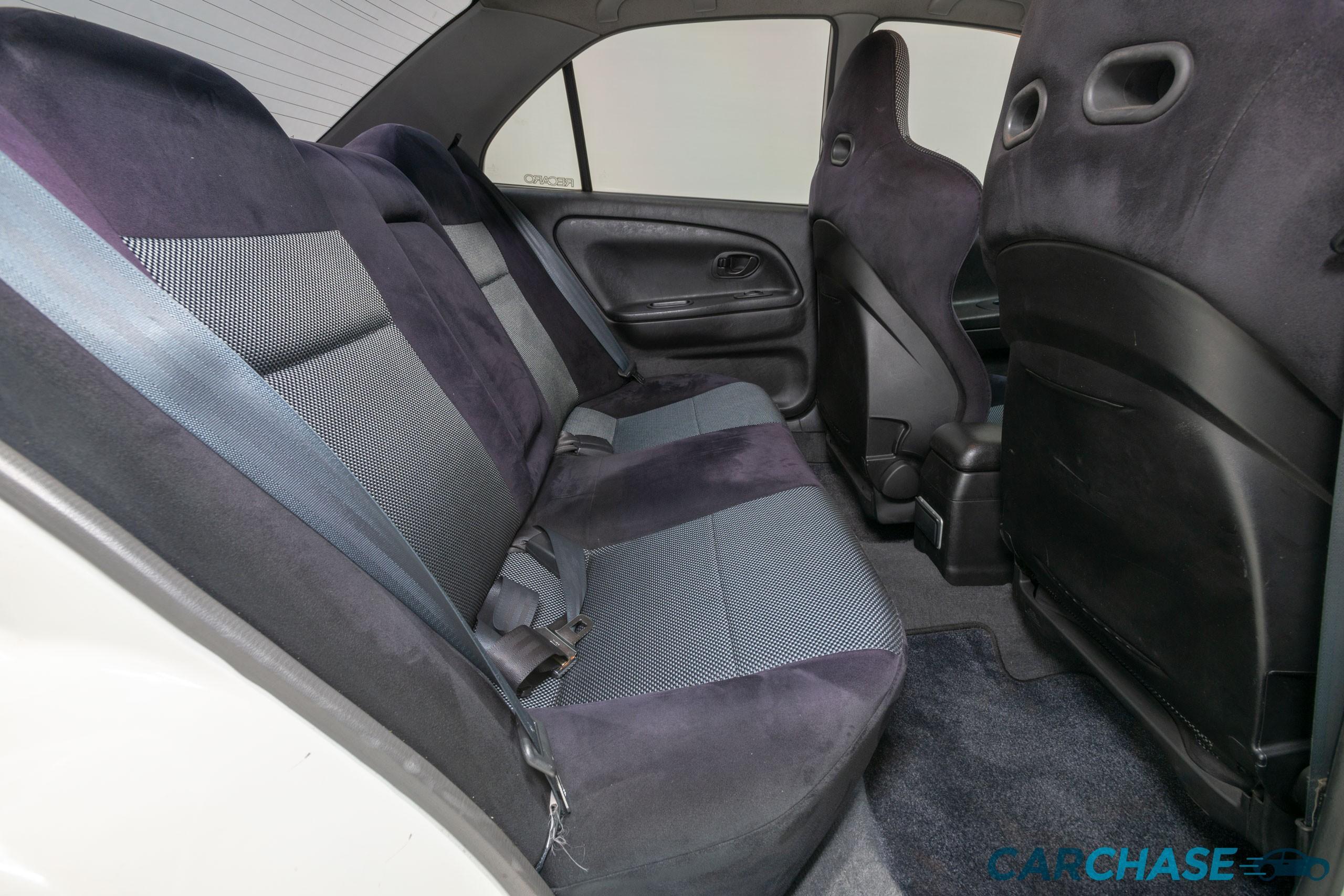 Image of driver rear profile of 1998 Mitsubishi Lancer Evolution V
