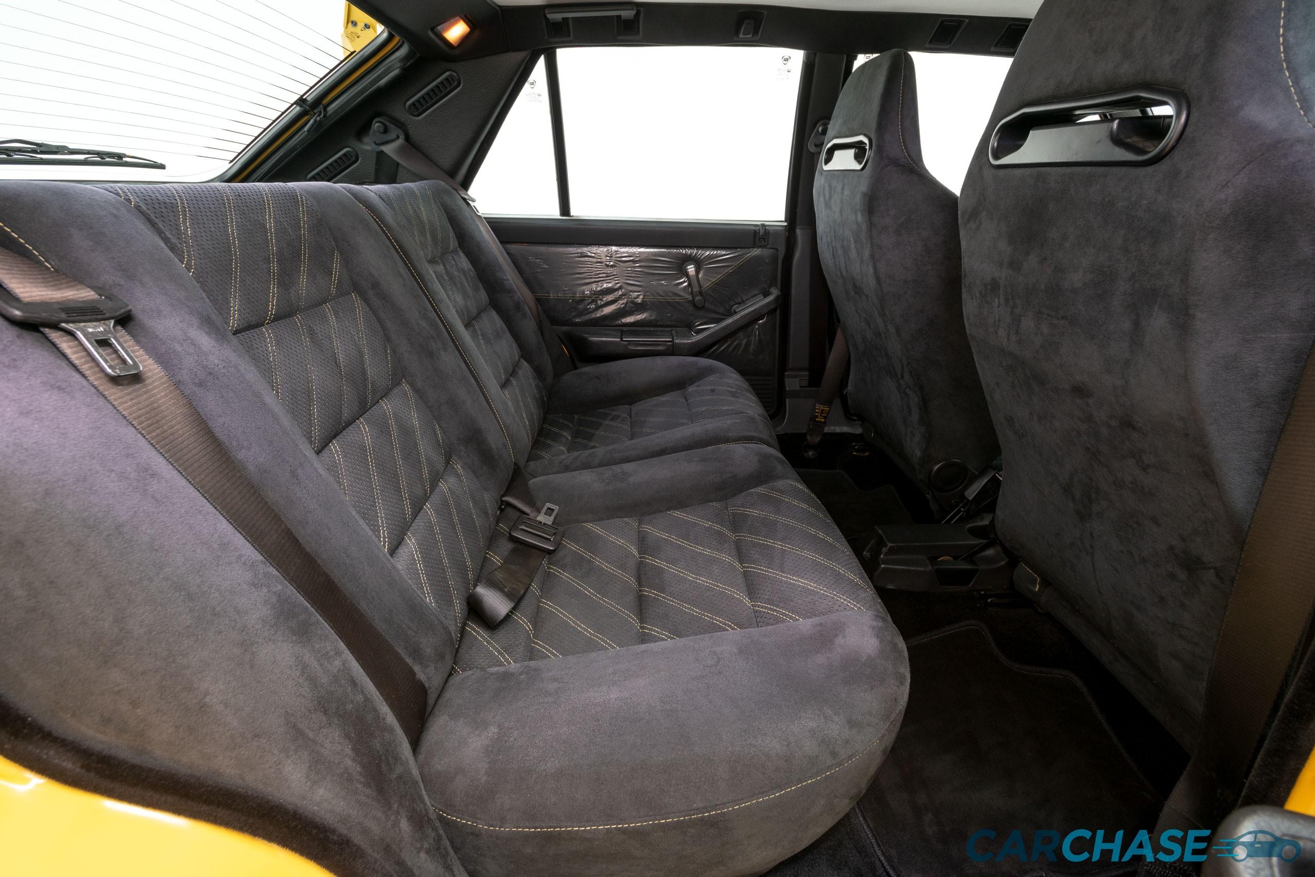 Image of passenger rear profile of 1993 Lancia Delta Integrale Evo 2 Giallo Ginestra