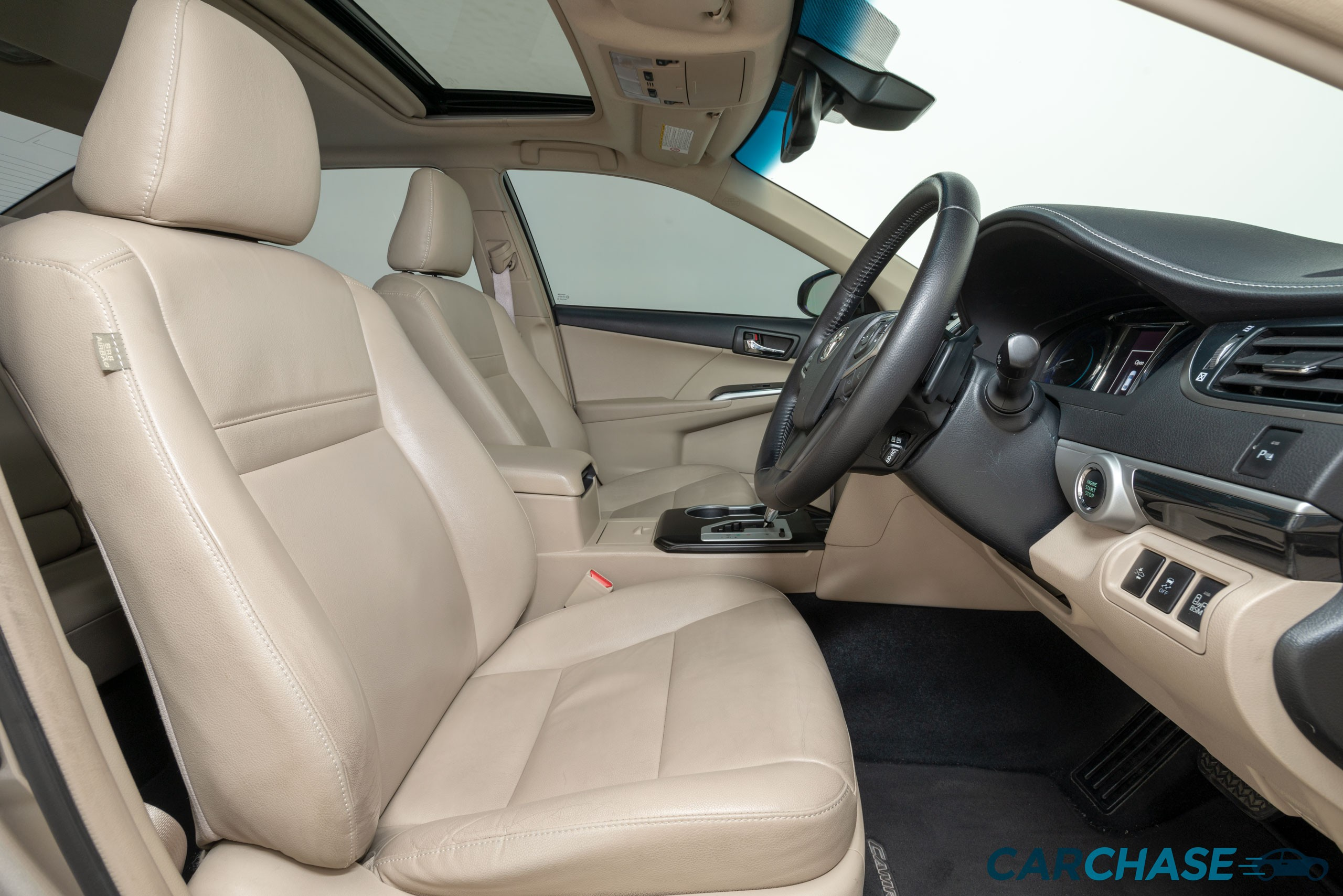 Image of driver front profile of 2015 Toyota Camry Atara SL
